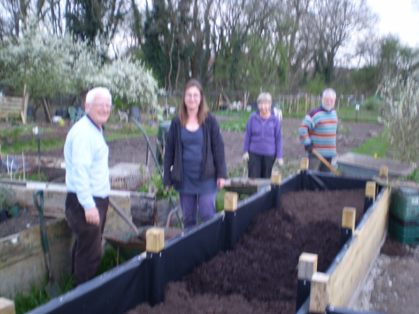 Picture of Dried of Barry, Rachael, Cath and Colin filling the beds with top soil and compost